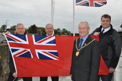 L to R: Duncan Brown, Harbours manager; Cllr Chris Tuke, Armed Forces Champion; Cllr Allan Wright, Convener of Moray Council; Clive Oxford, Harbourmaster.