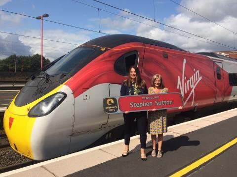 Virgin Trains' Amanda Hines presents Jane Sutton with one of the original Stephen Sutton nameplates