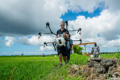 DJI Agras MG1-S arriving on the rice fields in Africa
