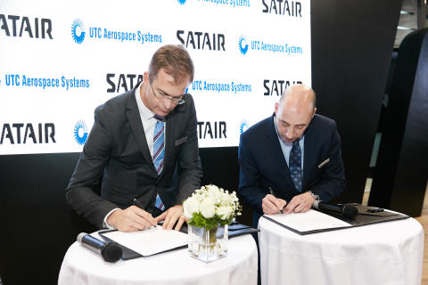 Bart Reijnen, CEO of Satair and James Holland, Actuation Systems Aftermarket General Manager of UTAS sign agreement