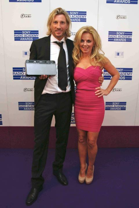 Robbie Savage wins Sony DAB Rising Star Award presented by Geri Halliwell - credit Jab Promotions