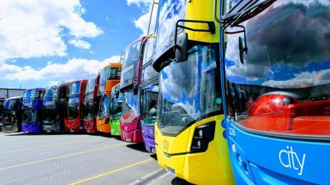 City buses line up in the Cowley depot