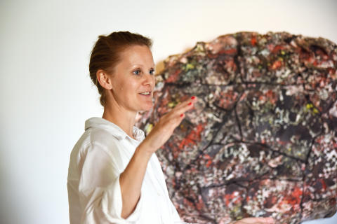 Randi Grov Berger presents Paradise II (Fractured) by Pekka Paikkari during a guided tour.