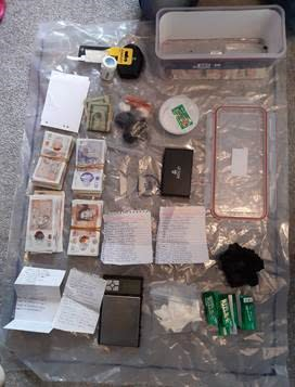 Officers recovered weapons, drugs and money