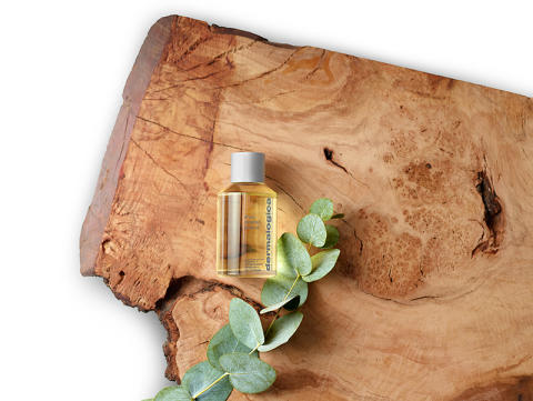 Body Oil on Wood with Ingredient