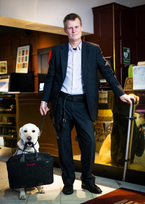 Magnus Berglund, Director of Accessibility Scandic, with service dog Dixi.