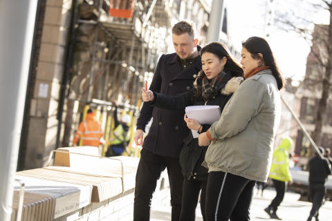 Alex Slack, Bigg Market Project Manager at NE1, pictured with two of the Northumbria students involved in the project,  Chang Shi Qian and Franz Pancho
