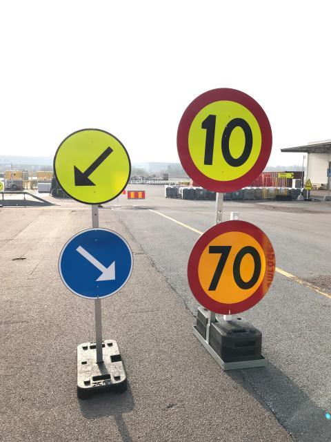 Limegul markering vid markering av vägarbete