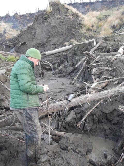 Dr Paul Mann taking samples of permafrost