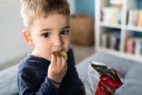 Child eating unhealthy snacks.jpg
