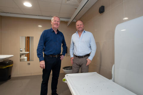Pictured is Councillor Eugene Reid with Tower Centre Manager Hugh Black in the new Changing Place toilet facility.