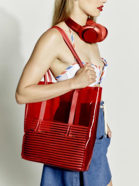 sony h.ear on red headphones with beach bag