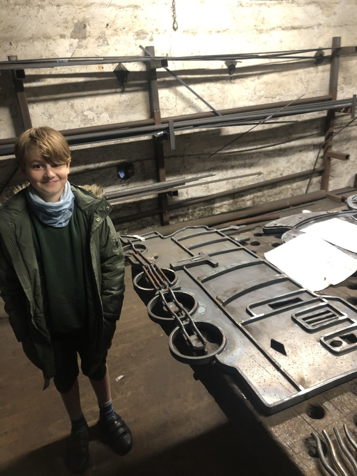 Children's train designs sculpted in steel for station display