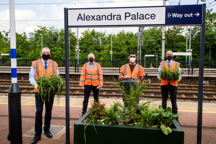 Rail Minister digs in to help stations and local youngsters bloom