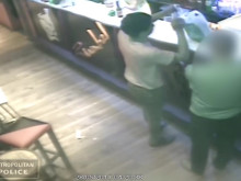 CCTV footage from inside the bar showing the suspect