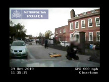 Dash cam footage of car driven at officer
