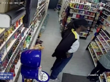 CCTV footage of shop worker being assaulted