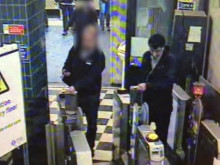 CCTV1 - Mohammadi walking through a ticket barrier at Colindale tube - mdr10-17