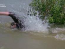 GORDON DIVES FOR SNAILS IN THE MEKONG RIVER