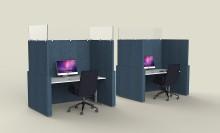 I Tyskland skiljs kontorsarbetarna åt av två meter höga skärmväggar