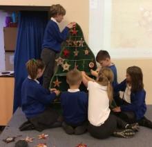Schoolchildren bring Christmas cheer to West Sussex station
