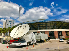 Leveraging satellite services to broadcast large scale sporting events