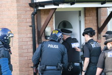 Police arrest 10 during morning raids in Liverpool and Manchester