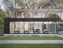 RECENTLY BUILT MODERN HOME STEEPED IN LOCAL HISTORY SITS ALONG RIVER IN WINNIPEG