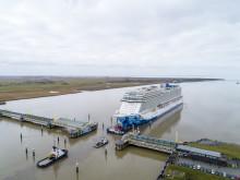 Norwegian Bliss begins her conveyance up river Ems