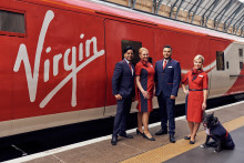 Picture Paw-fect! All change as Jake the trainspotting dog models new Virgin Trains uniform