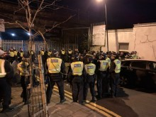 Police break up rave in east London as hundreds defy Covid regulations in packed railway arch