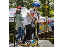 Enjoying the scooter training on the half pipe ramp in People's Park