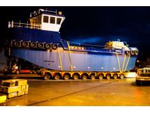 Dredger 'Selkie' on transporter wheels aiming for the slipway