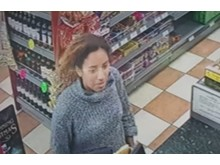 CCTV image of a woman officers would like to speak to in relation to a theft in Great Linford