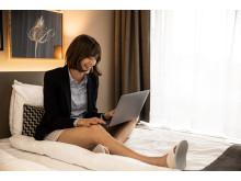 Scandic-Bed-Business-Meeting-Woman-Laptop-Skypemee
