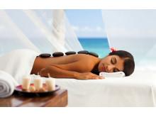 Kombinationen sol og afslappende massage på ferien er god for vintertrætte danske kroppe.