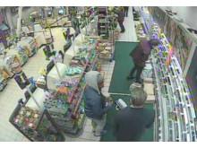 Matovu and Mr Michels in shop