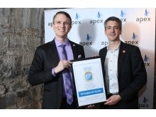 Philip Allport, Norwegian Director of Communications UK and Ireland, accepts the award APEX award from Joe Leader, CEO of APEX