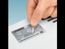 Labels med beskyttende laminat