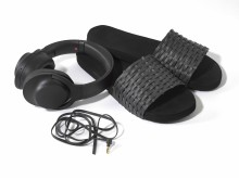 sony h.ear on black headphones with beach sliders