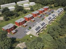 Översiktsillustration av det nya kvarteret med lägenheter och parhus, BoKlok Biodlaren i Göta, Lilla Edet.  Alla lägenhetshus kommer att ha solceller på taket, för en grönare miljö.