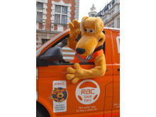Horace giving a wave from an RAC patrol van