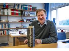 Leif Asp with a bobbin of carbon fibre yarn