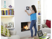 A woman placing the marker on the wall of her living room