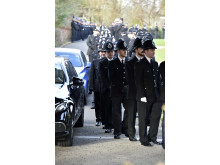 Officers file in to the chapel for PC Dan Clayton-Drabble