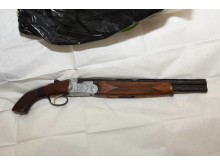 Shotgun recovered following warrant in Walton