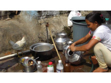 Woman cooking in the street