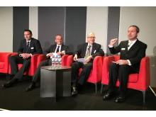 Mark Laudi moderating panel in Sydney