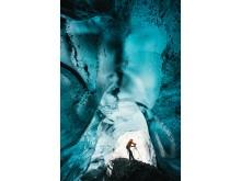 Fängslande bilder av Islands sällsynta isgrottor