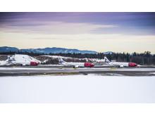 Tre Norwegian-fly på rad i vinterlandskap